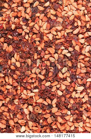 Dried wild rose tea grains as background