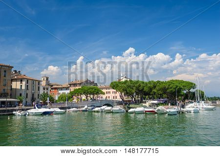 Desenzano, Lombardy, northern Italy, 15th August 2016: Small yachts and boats in harbor of Desenzano del Garda, lake Garda, Italy