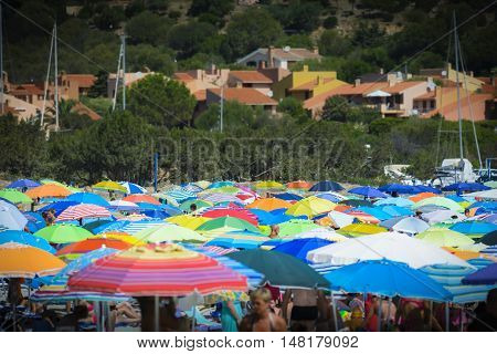 Colored sun umbrella on the beach during holidays