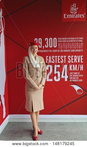 NEW YORK - SEPTEMBER 1, 2016: Emirates Airlines flight attendant at he Emirates Airlines booth at the Billie Jean King National Tennis Center during US Open 2016 in New York