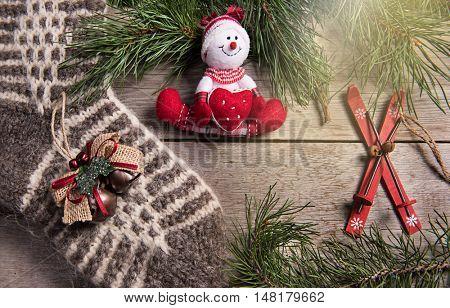 Christmas tree decoration snowman wooden texture background woolen warm wear new year wool socks