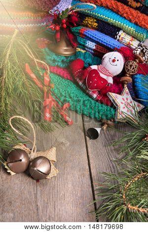 striped colorful wool texture handmade patten closeup macro blue red green yellow pink purple orange beige christmas decoration snowman wooden background