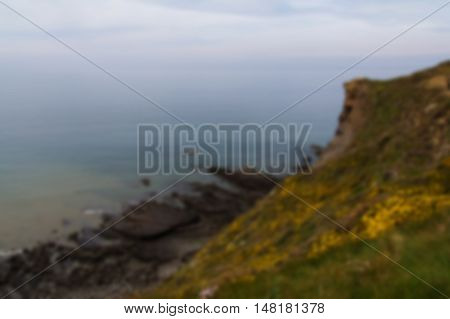 View Over The Coastline Near Widemouth Bay In Cornwall Out Of Focus.