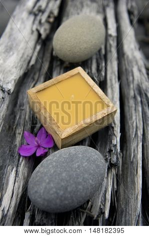 nature driftwood wood background with handmade candle with gray stone,orchid