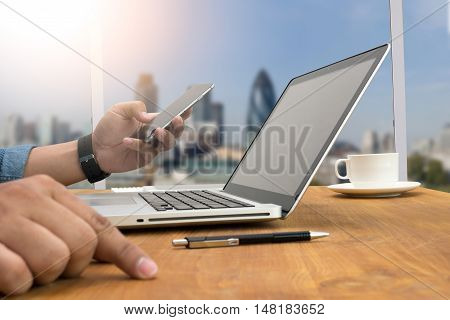 Cropped Shot Silhouette Of A Man's Hands Using A Laptop At Home, Rear View Of Business Man Hands Bus