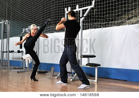 woman in the fitness gim working out with personal trainer coach