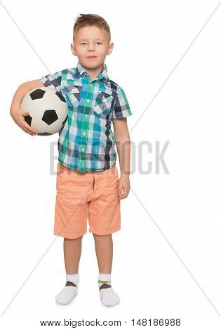 Beautiful little boy with a fashionable hairstyle on the head . The boy is holding under one arm a football . Portrait in full growth - Isolated on white background