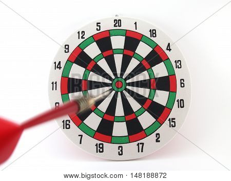 dart approaching the target isolated on white background, darts motion straight into the goal, concept about success is not far away