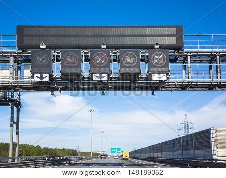 Traffic Enforcement Cameras Over Traffic Lanes