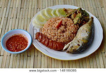spicy fried rice with shrimp paste sauce and mackerel on plate
