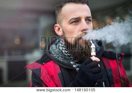 Young bearded man smoking