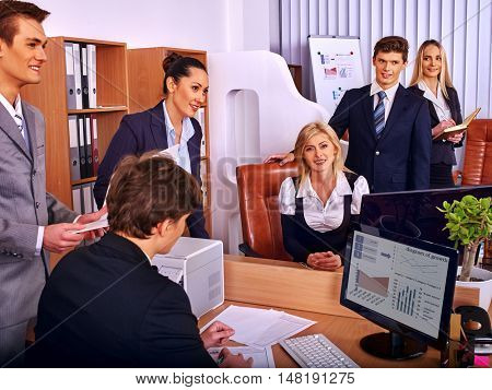 Happy group business people in office. Business man looking in business computer.