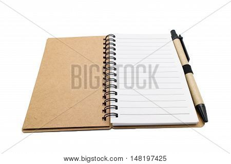 Opened recycle paper spiral notebook with pen isolated on white background