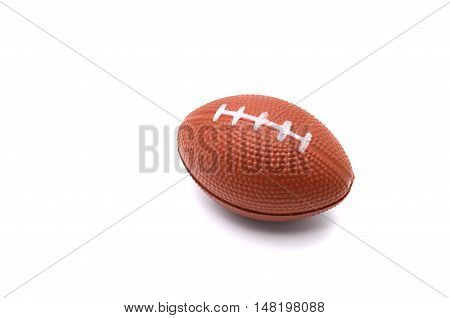 Stress ball american football toy isolated on white background.