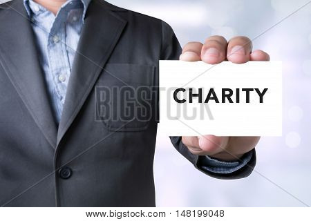 CHARITY DONATE Give Concept businessman working businessman working