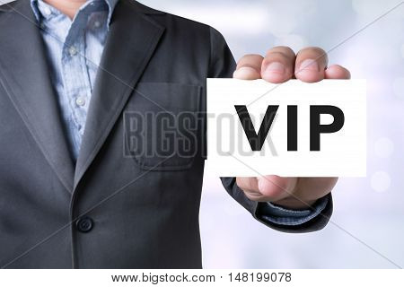 Businessman Message On The Card Shown On Blurred City Background