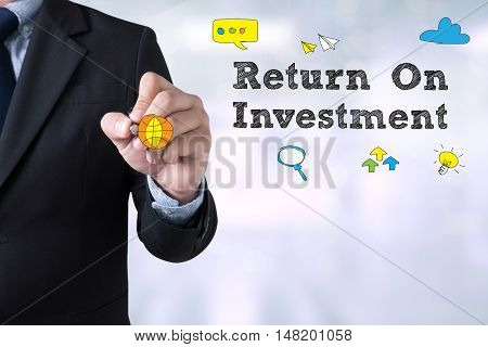 Man Drawing Roi Concept On Chalkboard (return On Investment)