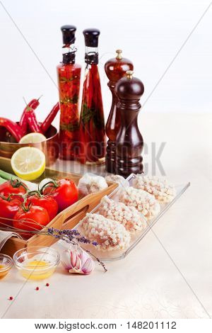 raw chops spices and ingredients for cooking isolated on white background
