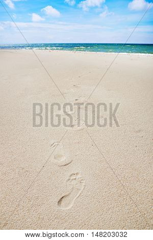 The humans footprints on the empty beach