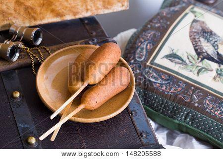 corn dog at the theater circus binoculars chest atmosphere corndog hotdog hot food snack lunch