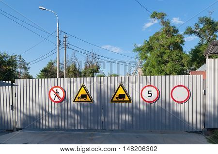 Road Signs On A Fence