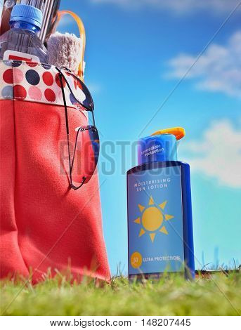 Suntan Lotion and Bag With Beach Items