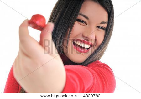 young woman isolated on white in red shirt eat sweet tasty chocolate