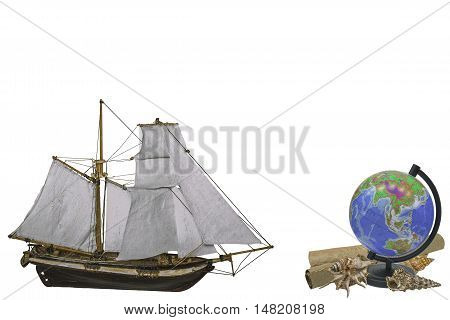 Travel vacation concept - Sailing ship and globe with seashell insulated on white background