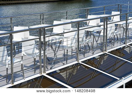 Cafe tables on the deck of a pleasure boat