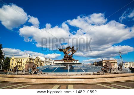 Minsk Belarus: August 25 2016: Three storks sculpture in the fountain in Independence Square