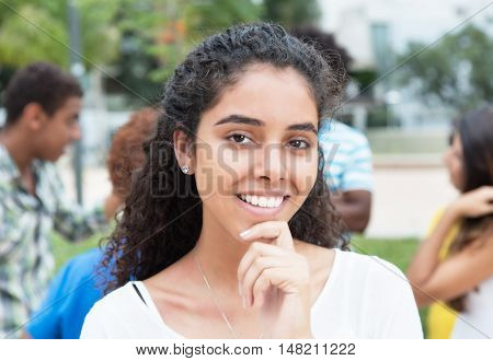 Laughing brazilian woman with multi racial outdoor in the city in the summer