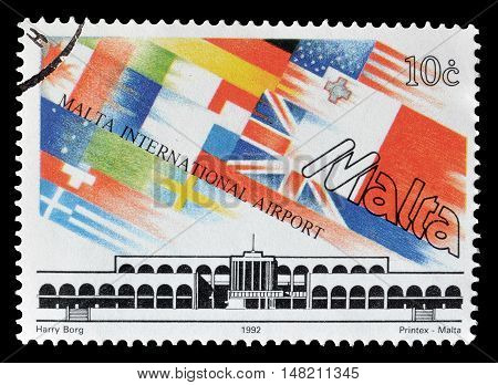 MALTA - CIRCA 1992 : Cancelled postage stamp printed by Malta, that shows Airport building and flags.