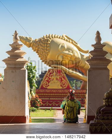 tourists posing in front of temple in koh samui thailand shot with selective focus and lens flare