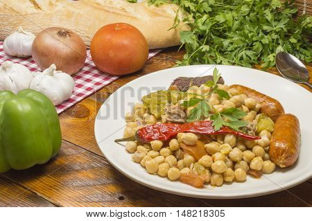 chickpea stew with pork sausages and vegetables