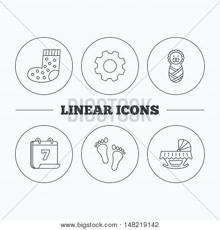 Footprint, cradle and newborn baby icons. Socks linear sign. Flat cogwheel and calendar symbols. Linear icons in circle buttons. Vector