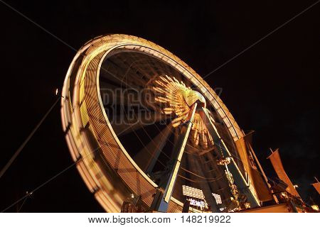 The high ferry wheel at the Oktoberfest in Munich at night