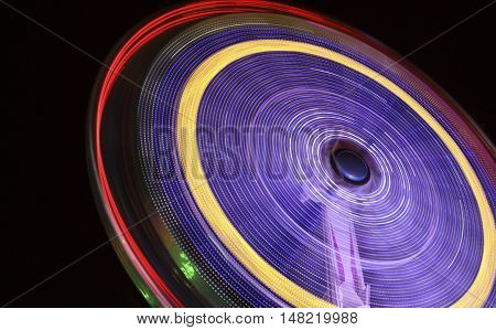 A rotating ride at the Oktoberfest at night