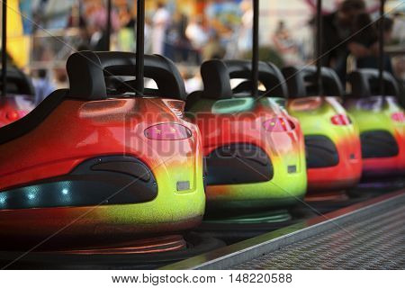 Oktoberfest Ride Bumper Cars in a row