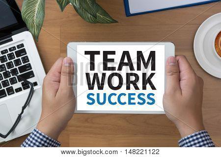 TEAMWORK SUCCESS CONCEPT man hand Tablet businessman working