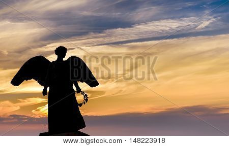 Angel Silhouette over bright sky background panoramic view