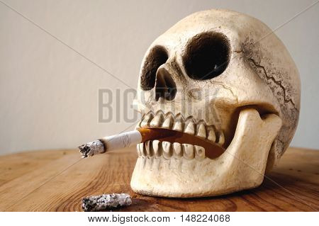 Human skull Smoking on vintage wood table