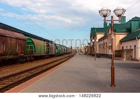 Part of a freight train near railway station peron