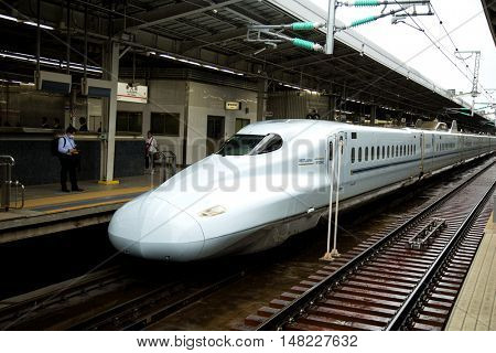 TOKYO-JAPAN JUNE 15, 2016:  The Shinkansen is a network of high-speed railway lines in Japan operated by five Japan Railways Group companies.  The maximum operating speed is 320 km/h (200 mph).