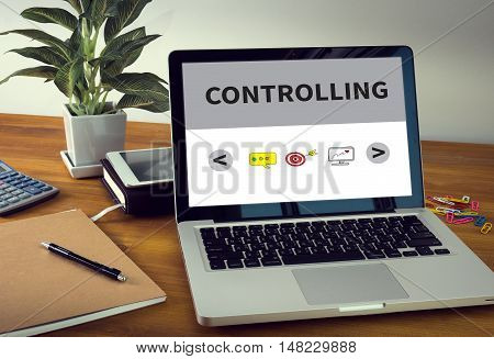 CONTROLLING Laptop on table. Warm tone businessman working