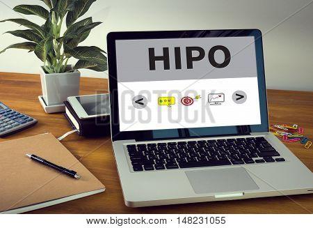 HIPO Laptop on table. Warm tone businessman working