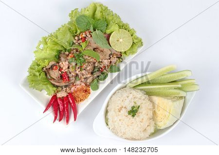 Sticky rice with spicy sour mixed herb salad of chicken and liver chicken . Top view