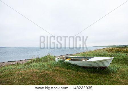 Boat aground on the grassy beach