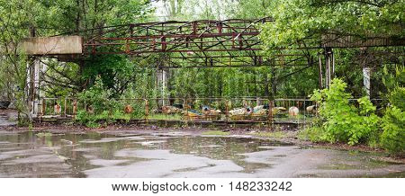 abandoned amusement park with cars in Pripyat