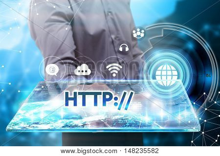 Business, Technology, Internet And Network Concept. Young Businessman Working On A Tablet Of The Fut