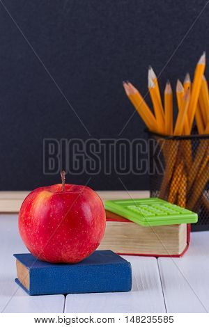 The School supplies on white wooden table